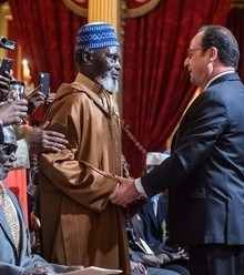 079105 french president francois hollande c rshakes hands with veterans during a ceremony to award french citizenship to former senegalese riflemen veterans e1492445117207 x220