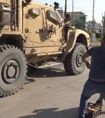 9283b9 syrians throw rotten fruits x220
