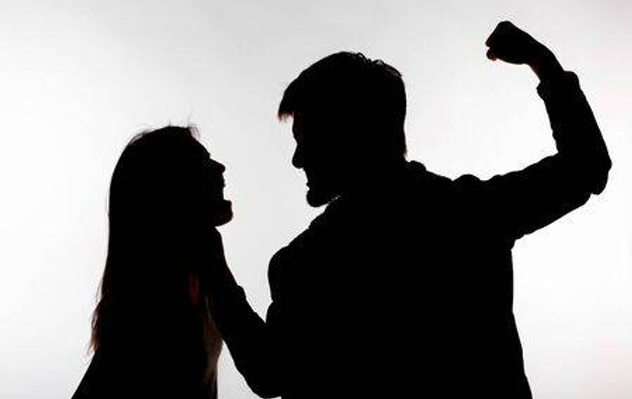Dqlws0 129557085 domestic violence and abuse concept silhouette of man beating defenseless woman h450