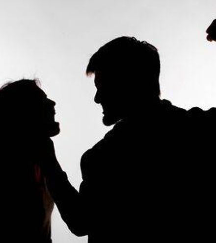 Dqlws0 129557085 domestic violence and abuse concept silhouette of man beating defenseless woman x220